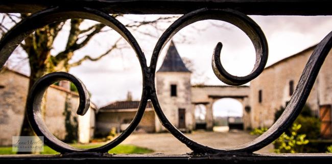 Porche through garden gate_